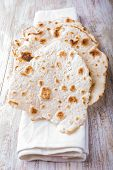 stock photo of whole-wheat  - Homemade whole wheat flour tortillas on a wooden table - JPG