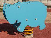 picture of hippopotamus  - Bouncy colorful spring playground equipment in public park plastic hippopotamus on springs - JPG