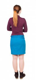 stock photo of jeans skirt  - back view of standing young beautiful  woman in jeans - JPG