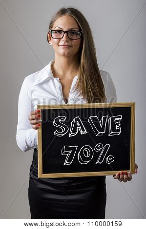 Save 70% - Young Businesswoman Holding Chalkboard With Text