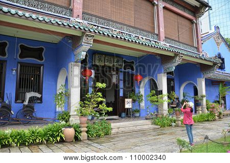 Unknown Visitor Takes A Photo Of Famous Cheong Fatt Tze, The Blue Mansion In Penang