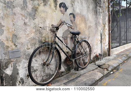 Little Children On A Bicycle Street Art Mural By Lithuanian Artist Ernest Zacharevic