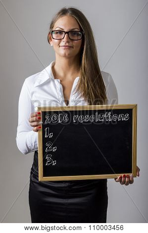 2016 Resolutions 1. 2. 3. - Young Businesswoman Holding Chalkboard With Text