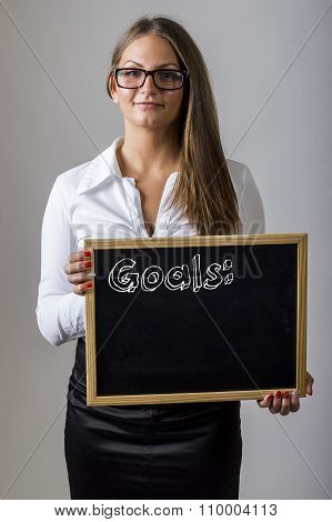 Goals - Young Businesswoman Holding Chalkboard With Text