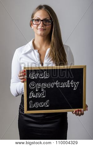 Grab Opportunity And Lead Goal - Young Businesswoman Holding Chalkboard With Text