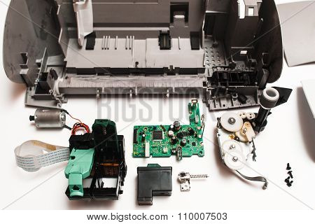 Parts Of The Broken Ink Jet Printer On White Background
