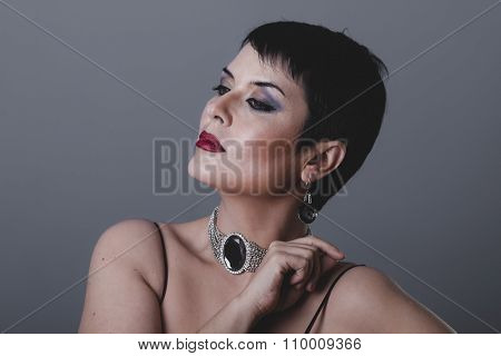 glamour, flapper dancer with dark short hair and jewelry
