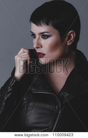 human serious gesture girl dressed in black leather jacket