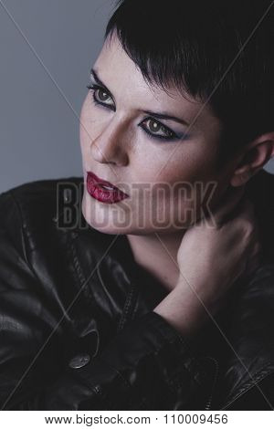 face, sensual and rebellious girl with black leather jacket