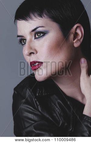 dark, serious gesture girl dressed in black leather jacket