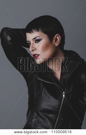 exotic sensual and rebellious girl with black leather jacket