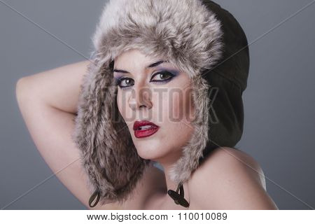 Luxury beautiful nude woman with furry winter hat girl cold