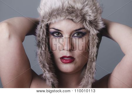 adult naked girl with Russian winter hat, cold