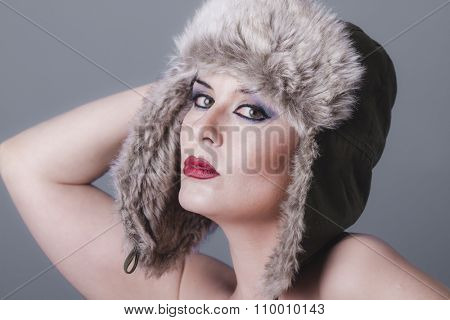lips, naked girl with Russian winter hat, cold