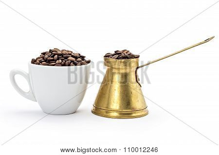 White coffee cup and traditional old brass coffee pot