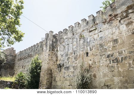 wall and tower of medieval castle in Marbella Andalucia Spain