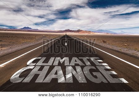 Climate Change written on desert road