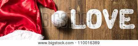Love written on wooden with Santa Hat