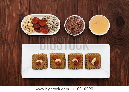 set of raw vegan halvah and ingredients in white plates over wood background