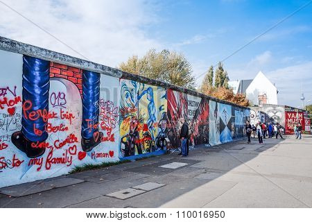 BERLIN, GERMANY- October 15, 2014: Berlin Wall was a barrier constructed starting on 13 August 1961. East Side Gallery is an international memorial for freedom. October 15, 2014 in Berlin