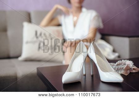 bride sitting in bathrobe