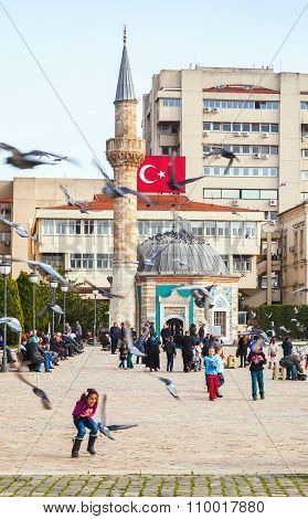 Children Play With Doves On Konak Square
