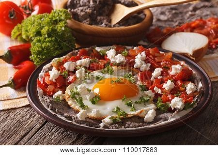 Mexican Food: Huevos Rancheros Close-up On The Table. Horizontal