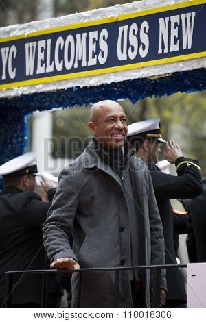 NEW YORK - NOV 25 2015: Television personality and former USMC Lt Commander Montel Williams smiles to the crowd from the USS New York float during the Americas Parade up 5th Avenue on Veterans Day.