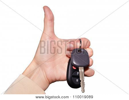 Driver hand with a car key isolated on white background.
