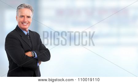 Smiling mature  businessman over blue background