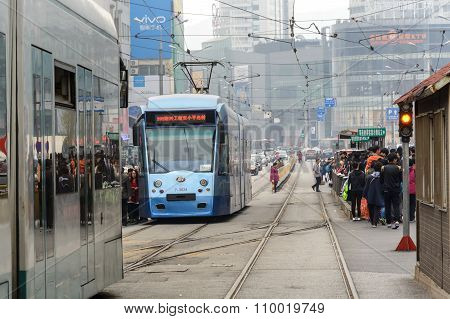 Crowd Of Passengers Are Waiting For Tram