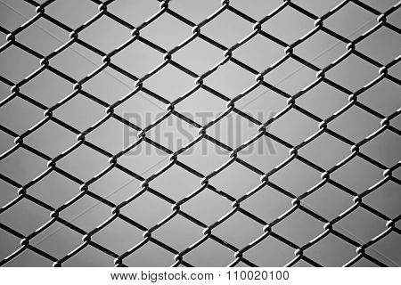 Close Up Of Wire Fence In Black And White. Background