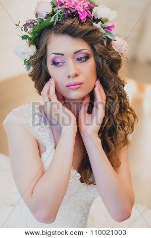 Beautiful bride brunette with  makeup in studio