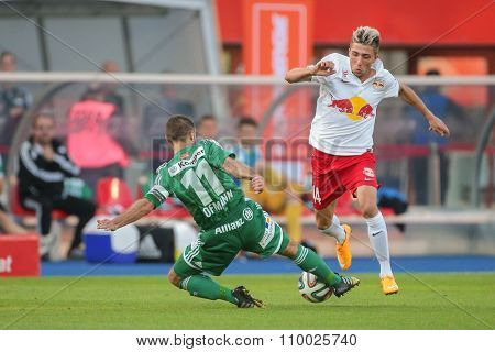 VIENNA, AUSTRIA - SEPTEMBER 28, 2014: Kevin Kampl (#44 Salzburg) and Steffen Hofmann (#11 Rapid) fight for the ball in an Austrian soccer league game.