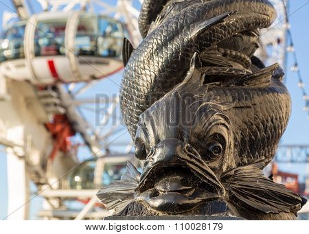 Carving Of Fish On Riverbank By London Eye