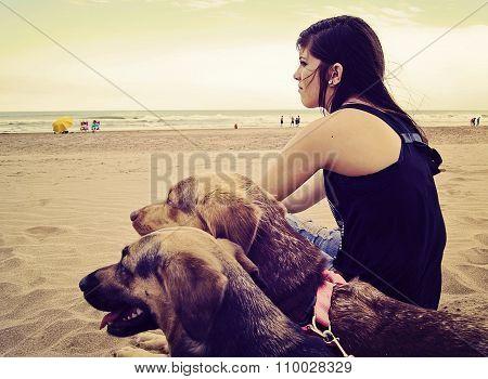 Girl sitting in the beach