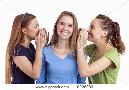 Portrait Of Three Happy Caucasian Females Sharing Secrets And Rumoring To Each Other To Ears.