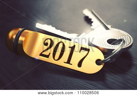 2017 - Bunch of Keys with Text on Golden Keychain.