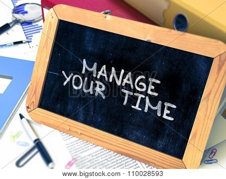 Manage Your Time. Motivational Quote on Small Chalkboard.