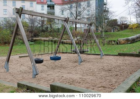 The Playground With Three Swings Hanging