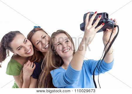 Youth Lifestyle Concept And Ideas. Three Young Positive Smilig Caucasian Ladies Making Self Photogra