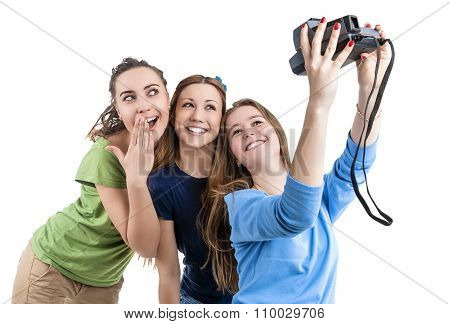 Three Young Positive Smilig Caucasian Ladies Making Self Photographs With Photocamera. Isolated Over
