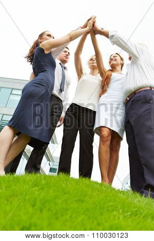 Successful business team doing high five for motivation