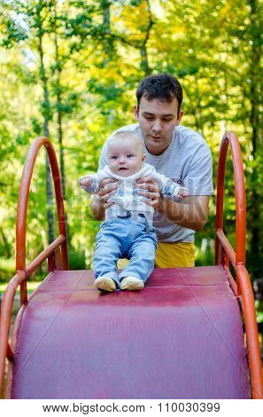 Father And Baby On A Slide