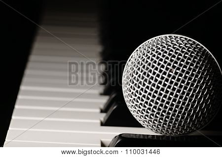 Microphone On A Piano Keyboard.
