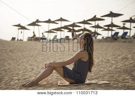 Girl Relaxes On A Beach