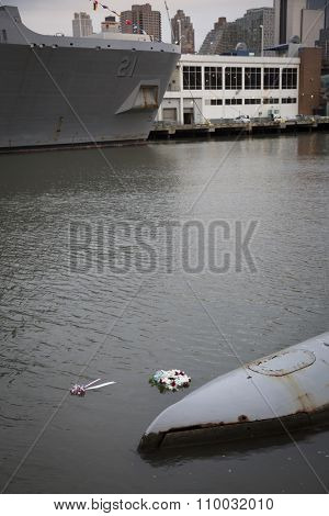 NEW YORK - NOV 25 2015: A wreath floats between the USS New York (LPD-21) an amphibious transport dock and the USS Growler (SSG-577) submarine after the wreath laying ceremony on Veterans Day.