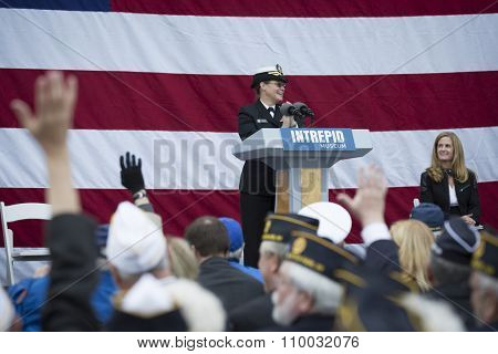 NEW YORK - NOV 25 2015: Rear Admiral Cynthia M. Thebaud, Commander, Expeditionary Strike Group 2 speaks to the audience at the Intrepid Sea, Air & Space Museum wreath laying ceremony on Veterans Day.