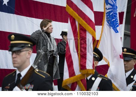 NEW YORK - NOV 25 2015: Army vet Loree Sutton, Commissioner of NYC Mayors Office of Veterans Affairs salutes during the presentation of colors on the Intrepid Sea, Air & Space Museum on Veterans Day.