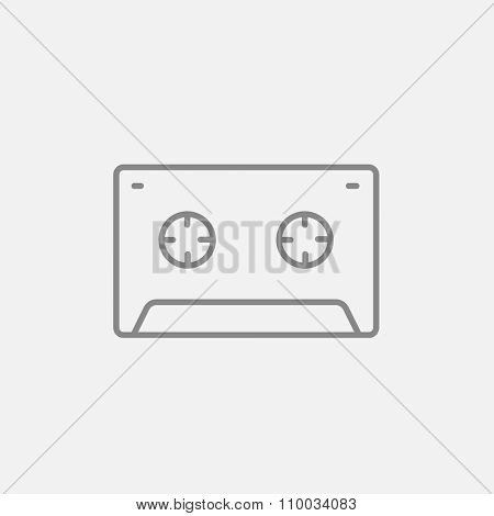 Cassette tape line icon for web, mobile and infographics. Vector dark grey icon isolated on light grey background.